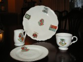 Collection of china made for George Hyde 44 High St. Ramsey. pre 1898, the centre crest on the large plate is that of Ramsey