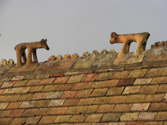 The roofline of 80 High Street, Ramsey, showing the ridge tiles depicting a bull and ram.