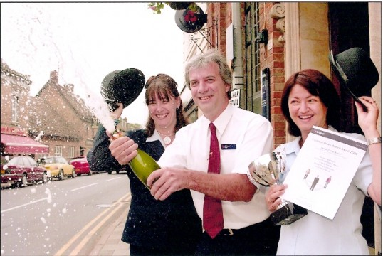 Outside NatWest Bank, High Street, Ramsey, members of staff with Customer Driven Branch Award.opyright RBS, see text. NatWest, Ramsey, Cambs