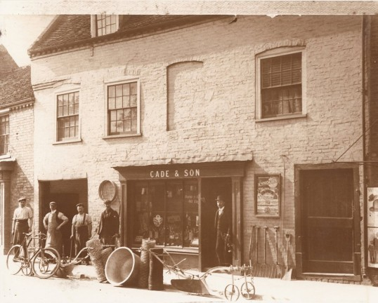 Charles Cade (snr) in the doorway of his shop at 58 High Street, Ramsey