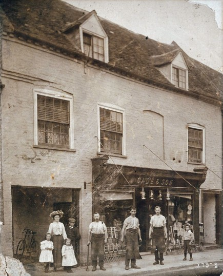 Cade & Son's, 58 High Street, Ramsey. Blacksmiths forges & workshop thro alley. Governess with Francis & Hazel Cade. Charles Cade (jnr) on right.