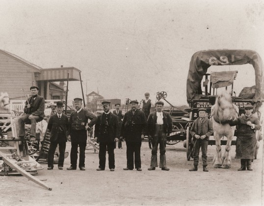 Cade & Son's loading the first binder to be imported from America at the North Station, Ramsey