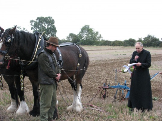 Rev. Darmody blessing the plow at Ramsey Rural Museum Country Fair