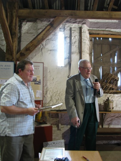 Ted Howard receiving the CCAN Group Award from Andrew Westwood-Bate at the CALH 2011 Agm and Award Ceremony for his book 'Life On The Fen Edge'