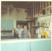 Arthur and Syliva Harding At the Fire at their Fish Shop in Great Whyte Ramsey
