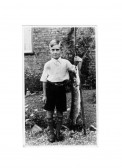 Leslie Complin Junior, holding a pike caught in the dyke Ramsey Merside Farm.