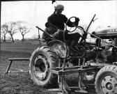 Cecil Seymour, driving Farmall (Model A) at Ramsey Mereside.