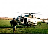 Tony Howard, (Royal Core Transport) delivering Christmas presents by Lynx helicopter at Hills Farm, Marriotts Drove, Ramsey Mereside