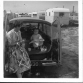 Mollie Howard, of Ramsey Mereside with son Anthony (Tony) in Morris Minor Traveller, Number VEW 30.