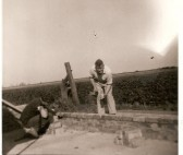 Bryn Carnelly & Ted Howard, building garages at New Cottages, Dairy Farm Rd, Ramsey Mereside