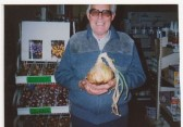 Ted Howard, with giant onion, wieght 3lb-8oz.