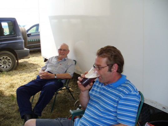 Ted Howard and Ian Hopkins, sitting in the shade, of Sams hot dog stall, at the Magpas ploughday held at Bury Fen, Cambs.