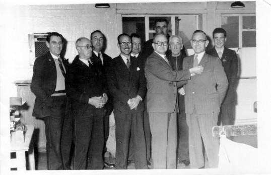 Ernie Greenwood, being presented with a service medal from the Huntingdon Post Office  Representative in 1956.  At Ramsey Sorting Office.