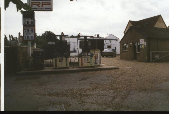 Rose's Petrol station off New Town Green during demolition.