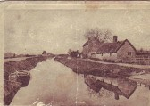 View of houses on Stocking Fen, Ramsey. Fertilizer Factory on the left on the Factory Bank.