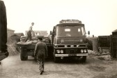 Les Complin and Derek Barnard loading a G.G.Paworth Ltd of Ramsey Mereside lorry (1965)