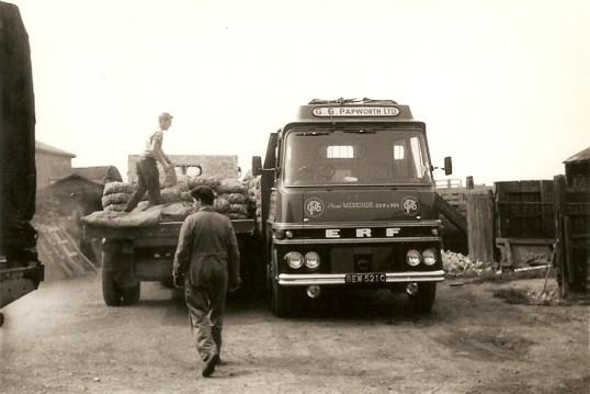 Les Complin and Derek Barnard loading a G.G.Paworth Ltd of Ramsey Mereside lorry (1965)
