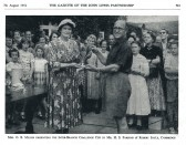 Mr H S Parsons of Robert Sayle receiving the Challenge Cup from Mrs O B Miller.