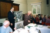 Lorna Howard cutting the cake at the Diamond Birthday Tea