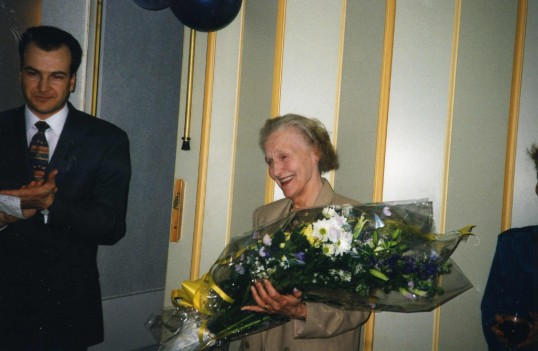 Eilean Starns with her bouquet, presented by Simon Fowler on the occasion of her retirement from Robert Sayle.