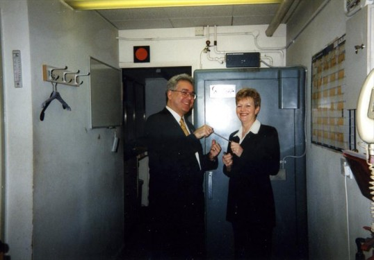 Liz Richardson hands over the key of the Robert Sayle Cash Office to Jim Bullock