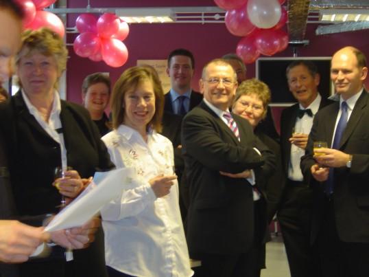 Partners enjoy Sue Hooks' retirement party.