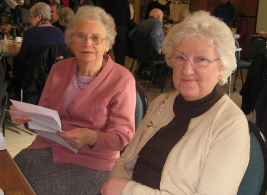 Margaret Caldecoat and Cynthia Yeo who both worked in Robert Sayle gift department for over 40 years each