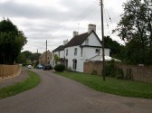 Church Road, Glatton showing Butts House.