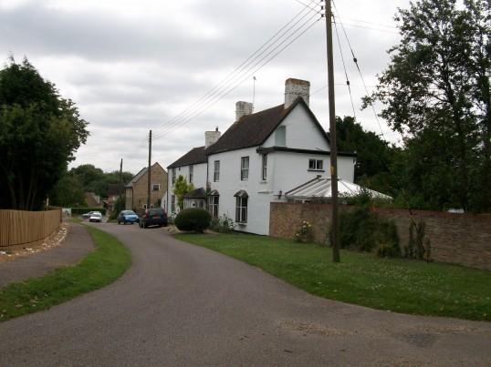 Church Road, Glatton showing Butts House.