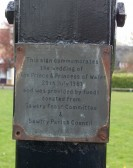 Commemorative Plaque on post of village sign, Sawtry.