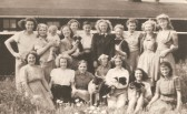 Jenifer Eldridge (now Morgan) 3 years old with the Land Army Girls in Sawtry