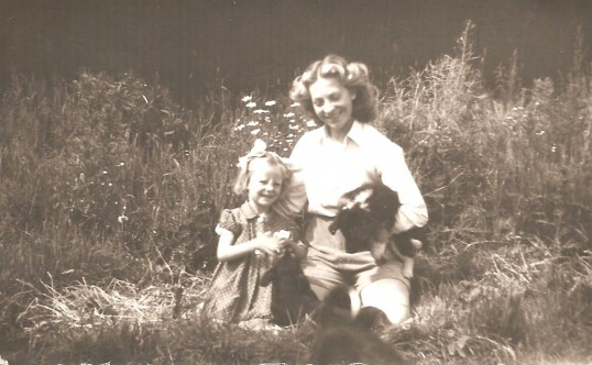 Jenifer Eldridge (now Morgan) 3years old with a Land Army Girl called Eileen in Sawtry.
