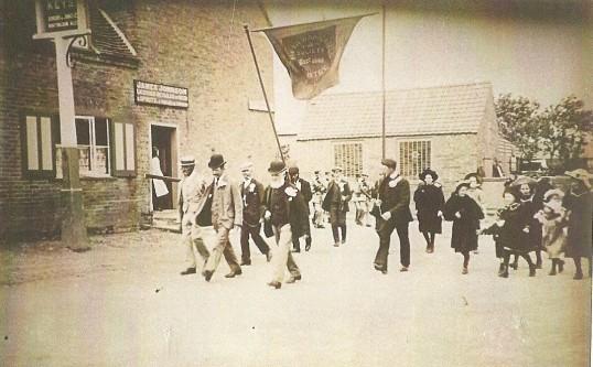 Feast Week Parade Sawtry' passing the Cross Keys Inn. When James Johnson was Landlord.