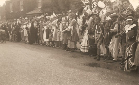 King George 6th Coronation celebrations in Sawtry.( High Street opposite what is now Thomas Morris.)