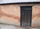 The door to the Lock Up situated on the east side of the Village Green Sawtry.