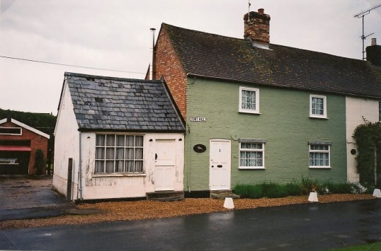Saddlers Cottage Tort Hill Sawtry, the white building on the side was James Barnes Mudd's Saddlery which no longer exists.