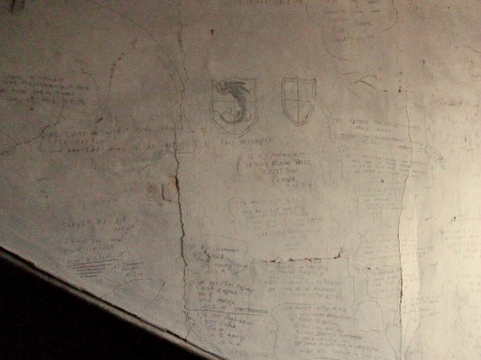 Writings on the walls in the attic at Woolpack Farm Conington.Made by Betty Toulmin (nee Sanders)