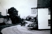 School Hill Sawtry. Showing the Bell Inn and the Blacksmiths Shop.(Note only one car to be seen)