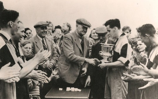 Sawtry Sports Club winners Hunts League Div 2 1948-1949. Roy Jackson receiving the Cup.