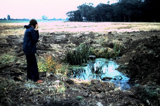 St. Judith's Archeological Dig Sawtry.(Pond in a sad state, Joan Bunting taking a look.)