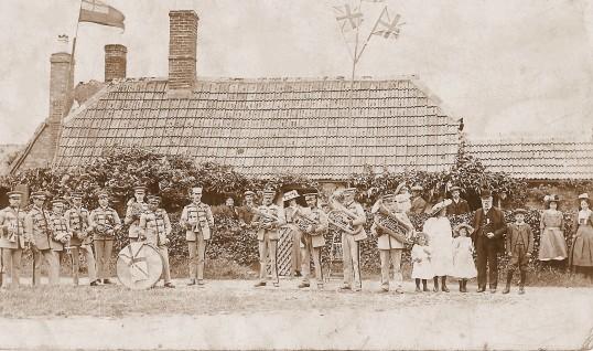 Sawtry Brass Band outside Tudor Cottage, Tinkers Lane Sawtry. (King George V coronation celebrations.)