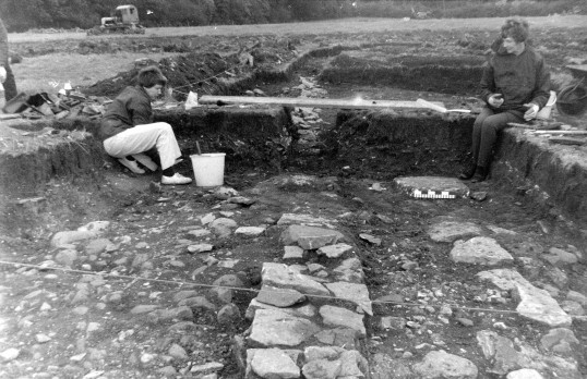 St. Judith's Archaeological Dig Sawtry.(Two volunteers beside one of the walls.)