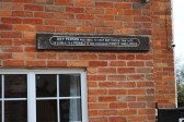 Old railway sign from a level crossing or station, on the wall of Oddfellows Cottage Sawtry.