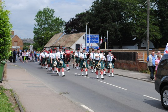 Sawtry Carnival, The Peterborough Pipe Band leading the parade.
