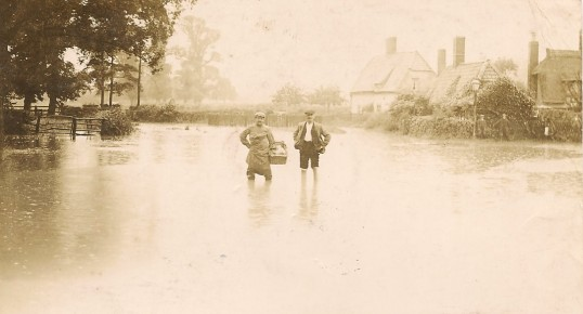 Flood at the junction of Tinkers Lane and Church Street Sawtry. Didn't seem to deter Harry the delivery man.