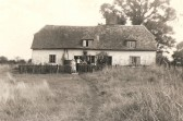 The Kitteringham Family outside their cottage in Glatton Road Sawtry.