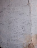 Writings on the walls in the attic at Woolpack Farm Conington. Made by Betty Toulmin (nee Sanders)