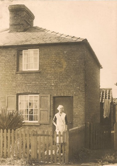Mrs Mary Maria Woodbridge, outside her cottage next to the blacksmiths, Green End Sawtry.