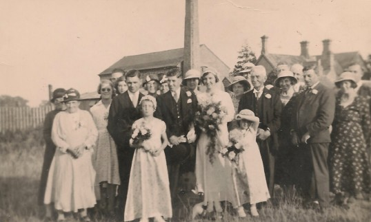 The wedding of Wally Sisman to Margaret Woodbridge. Photo taken behind the Old Granary Sawtry.   Both of this Parish.