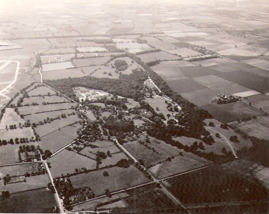 Aerial view of Holme Village during WW 2. Note the runways of the Glatton Air Base on the left.